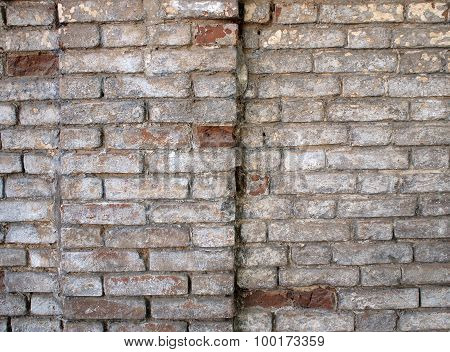 Detail Of A Wall Of An Old Red Brick With White Coating