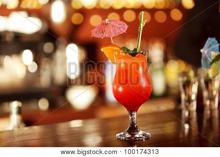 Cocktail on bar counter on bar background