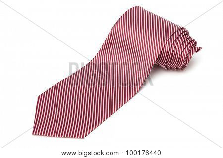 folded red necktie on a white background