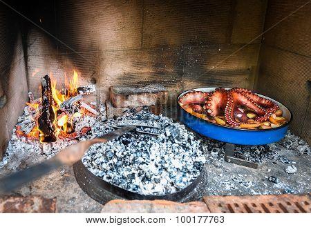 Preparing And Cooking Of Octopus In Traditional Balkan Greek Mediterranean Meal Peka
