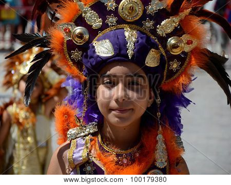 Girl playing the role of Moor in Moors and Christians Parade. Carboneras. Spain.