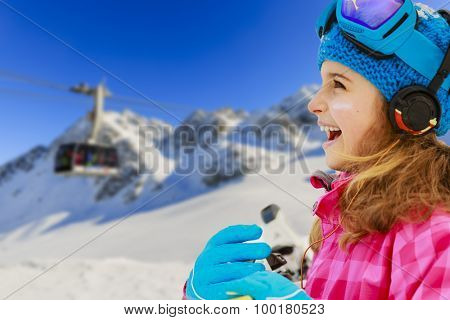 Winter vacation, snow, skier - girl enjoying winter
