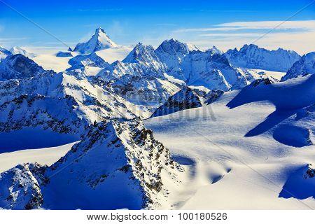 Panorama of Snow Mountain Range Landscape with Blue Sky at Mt Fort Peak Alps Region Switzerland