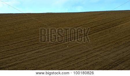 freshly plowed field in summer