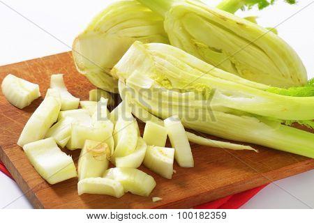 detail of fennel bulbs on wooden cutting board