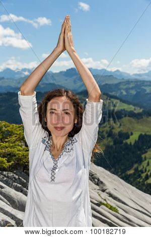 Woman In Namaste Pose In Nature