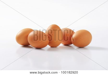 organic eggs on white background