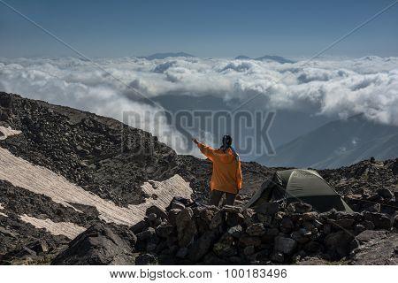 Tourist  Contemplates Clouds