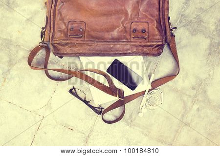 Leather Bag With Blank Diary, Cell Phone, Headphones And Glasses