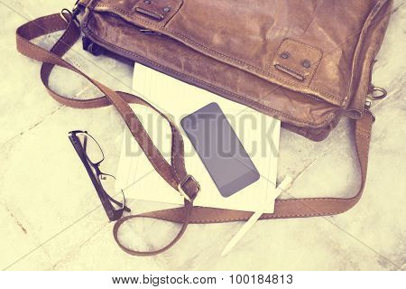 Leather Bag With Blank Diary, Cell Phone, Headphones And Pencil