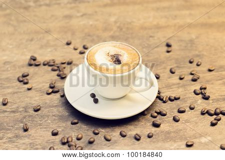 Cappuccino And Coffee Beans On A Table