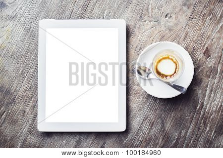 Blank Digital Tablet With Cup Of Coffee On A Wooden Table, Mock Up