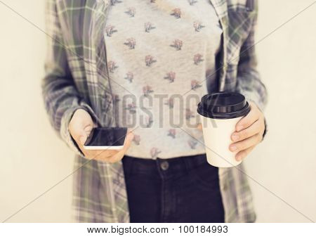Hipster Girl With Cell Phone And Coffe Mug