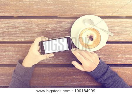 Girl With Cell Phone And Cappuccino Outdoor, Vintage Photo Effect