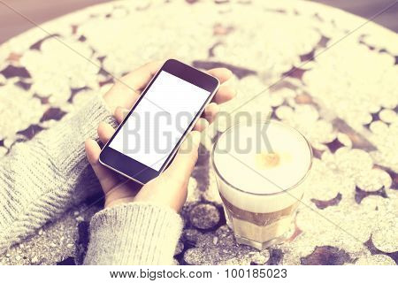 Girl Keeping Cell Phone And Coffee Outdoor