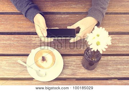 Girl's Hands, Cell Phone And Cappuccino, Vintage Photo Effect