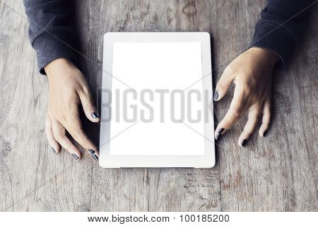 Girl Hands With Blank Digital Tablet On A Wooden Table, Mock Up