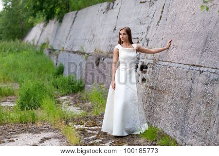 Girl In White Dress At The Wall