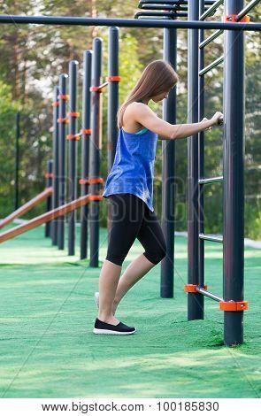 Beautiful Girl In Sportswear On The Playground