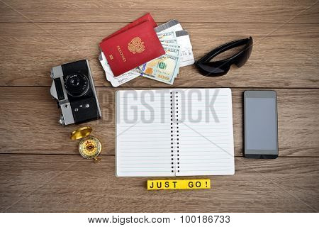 Retro style travel stuff on wooden table
