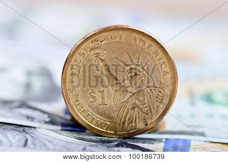 coin one dollar against the background US dollars background