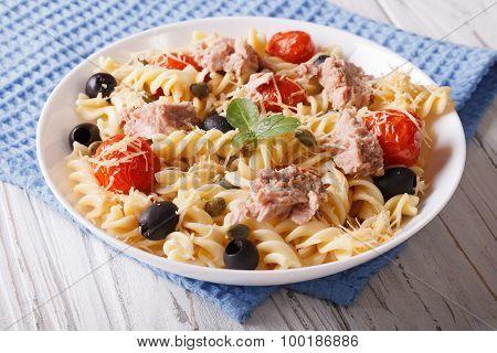 Fusilli Pasta With Tuna, Tomatoes And Parmesan On The Table. Horizontal