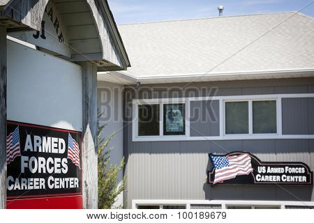 NEWTON, NJ-JUL 2015: The Armed Forces Career Center sign outside the military recruitment station for the Army, Navy, and Air Force in Newton, NJ.