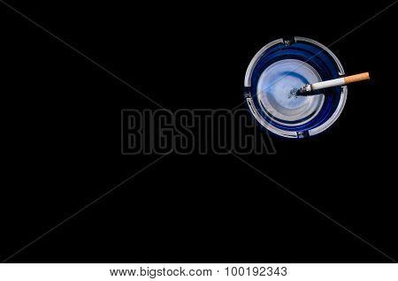 Closeup of cigarette on ashtray