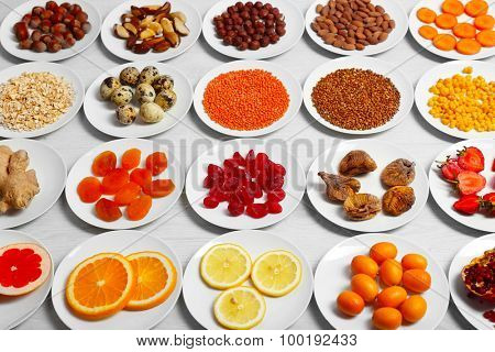 Set of orange products on wooden table, closeup