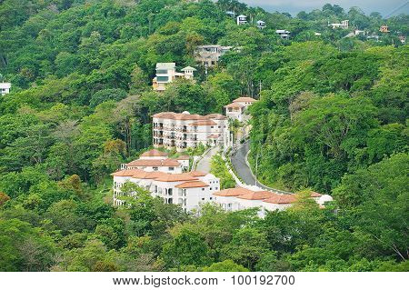 View to the hotels buildings in tropical forest in Quepos, Costa Rica.