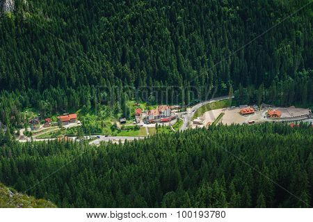Bird view from Suhardul Mic mountain to populated valley in Red Lake AKA Lacu Rosu area, Carpathians Romania.