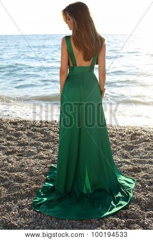 Beautiful Girl With Blond Hair Wears Luxurious Green Dress