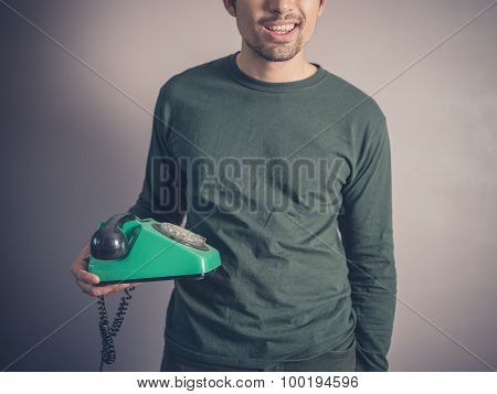 Happy Young Man With Vintage Phone