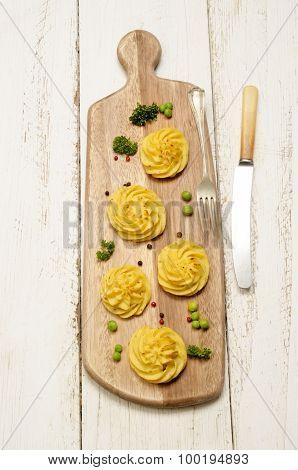 Duchess Potato On A Wooden Board