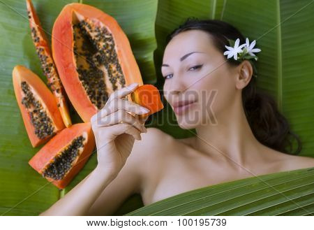 Beautiful Caucasian Woman With Fresh Fruit Papaya (outdoors). Healthy Natural Exotic Food