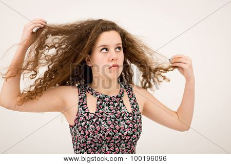 Ginger Teenage Girl Playing With Hair Looking Up