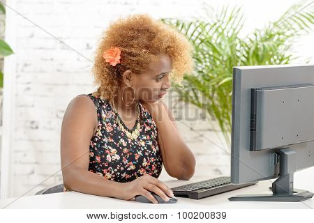 A Young African Woman Working On His Computer