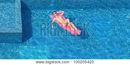 Top View Of Beautiful Tanning Woman In Pool