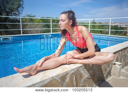 Attractive Brunette Woman Doing Stretching Exercise Near Swimming Pool
