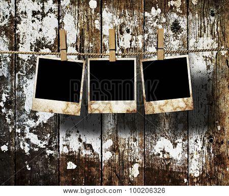 Aged photo frames on wood background