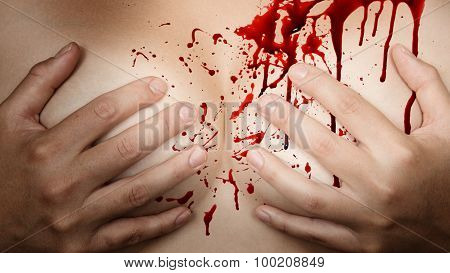Hands Covering Breasts - Blood