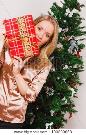 Beautiful girl with present