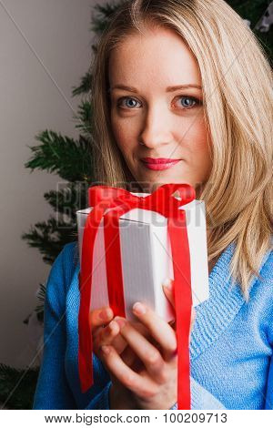 Nice woman keeping present in her hands