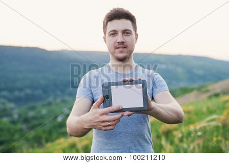 Man Holding An Ebook In Front And Touches The Screen