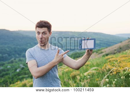 Man Standing Holding An Ebook With Surprise On Face