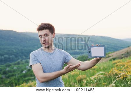 Man Standing On The Hill Hold An Ebook And Smiling Strange