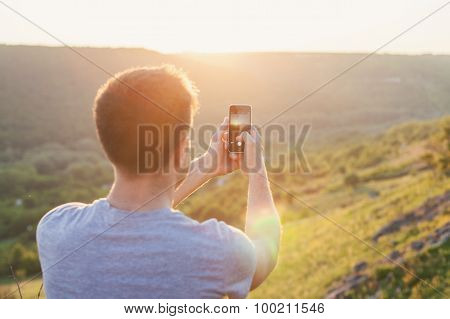 Man Takes A Picture By Phone