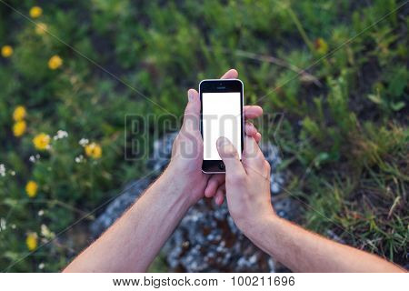Men's Hands Hold The Phone With The White Screen And Touch Display