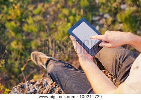 Men's Hands Touch Screen Of An Ebook