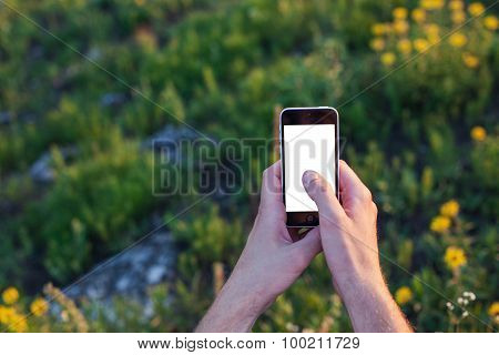 Men's Hands Touch Screen Of The Phone